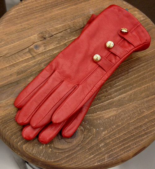 These Italian leather gloves with with shiny golden buttons are sure to please!